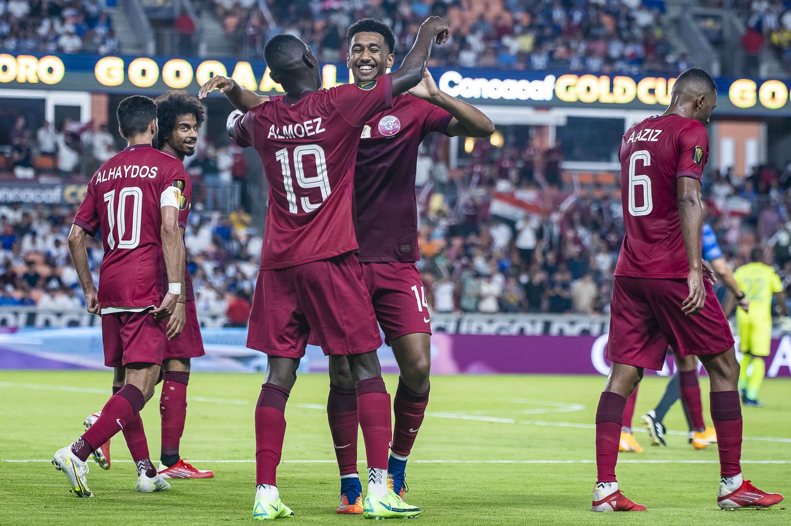 Qatar fend off Honduras to claim Group D